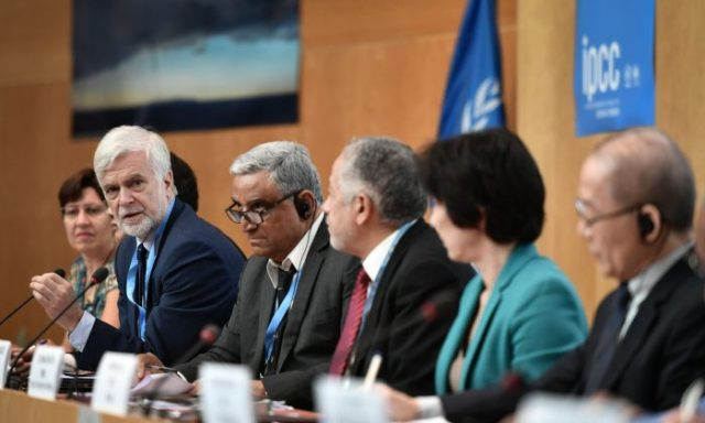 Intergovernmental Panel on Climate Change (IPCC) working group III co-chair Jim Skea (2nd L) answers a question during a press conference on a special IPCC report on climate change and land on August 8, 2019 in Geneva. - Humanity faces increasingly painful trade-offs between food security and rising temperatures within decades unless it curbs emissions and stops unsustainable farming and deforestation, a landmark climate assessment said the IPCC. Negotiators from 195 countries on August 8, 2019 finalised the most comprehensive scientific assessment yet of how the land we live off affects climate change, after marathon talks in Geneva. (Photo by FABRICE COFFRINI / AFP)        (Photo credit should read FABRICE COFFRINI/AFP/Getty Images)