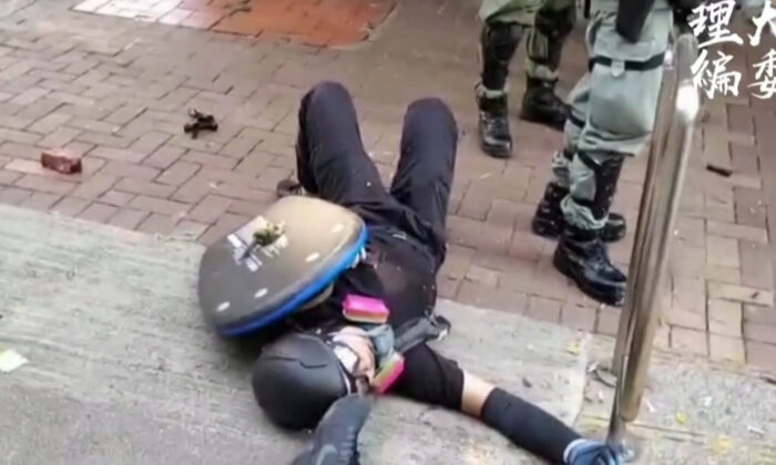 Footage shows the protester lying on the ground after being shot during clashes with police in Tsuen Wan, Hong Kong on Oct. 1. 2019. (HKPUSU Press Committee)