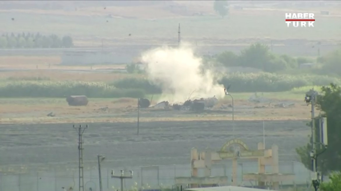 Smoke rises from an explosion in the border town of Tel Abyad