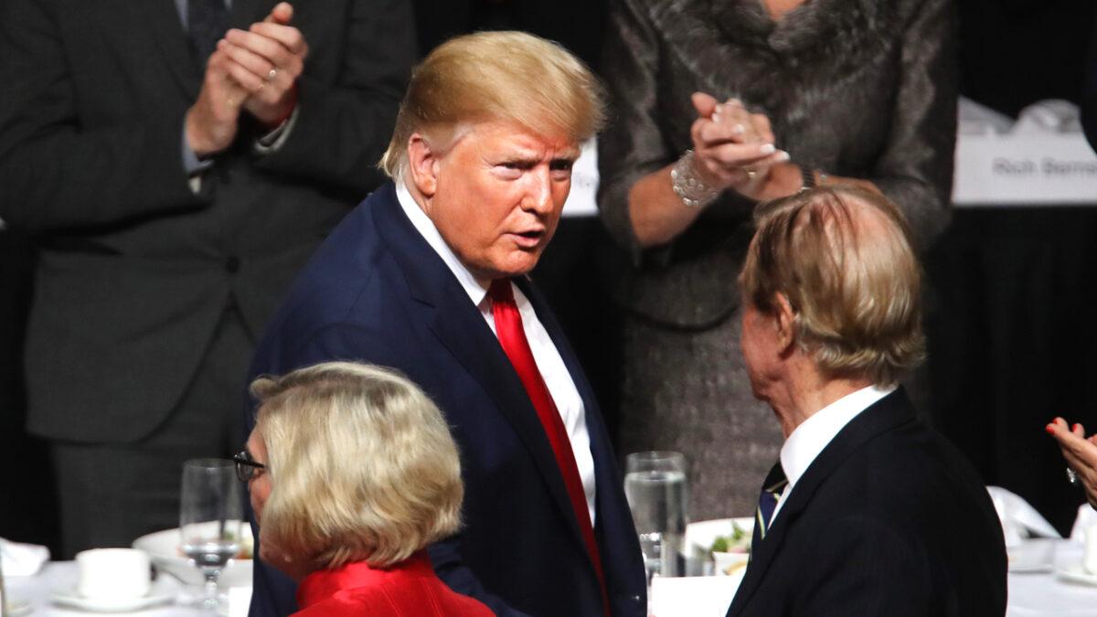 President Donald Trump exits the podium