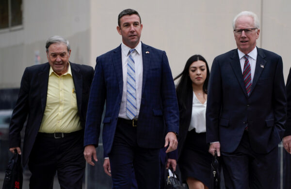 U.S. Representative Duncan Hunter arrives at court with his father Duncan Hunter Sr. and his lawyer, where he is expected to plead guilty to federal charges stemming from allegations that he and his wife misused campaign funds in San Diego.