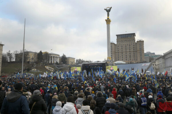 Activists attend a rally in central Kyiv, Ukraine, Sunday, Dec. 8, 2019. Several thousand people rallied Sunday in the Ukrainian capital of Kyiv to demand that the president defend the country's interests in this week's summit with Russia, Germany and France on ending the war in eastern Ukraine. (Efrem Lukatsky/ AP Photo)