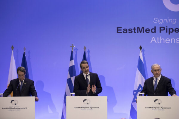 Israeli Prime Minister Benjamin Netanyahu (R) Greece's Prime Minister Kyriakos Mitsotakis,(C) and Cypriot President Nicos Anastasiadis, (L) attend a joint news briefing, in Athens, Thursday, Jan. 2, 2020. The leaders of Greece, Israel and Cyprus met in Athens to sign EastMed pipeline deal. (Yorgos Karahalis/AP Photo)