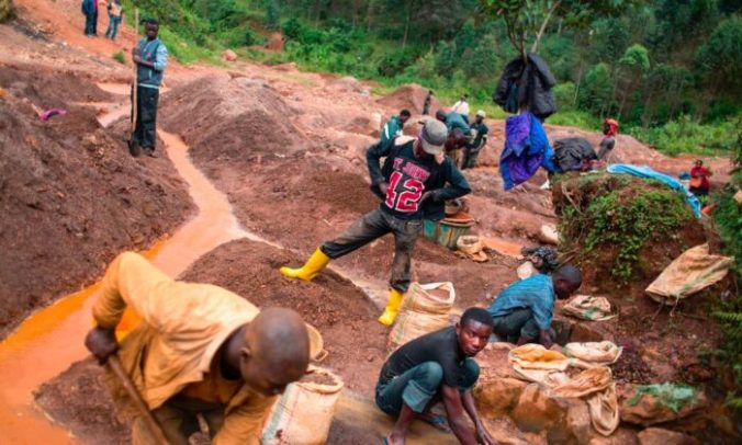 People work at the Kalimbi cassiterite artisanal mining site north of Bukavu, in the Democratic Republic of Congo, on March 30, 2017. (Griff Tapper/AFP via Getty Images)