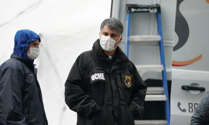 A member of the NYC Medical Examiner's Office at the site as workers build a makeshift morgue outside of Bellevue Hospital to handle an expected surge in CCP virus victims in New York City on March 25, 2020. (Bryan R. Smith/AFP via Getty Images)
