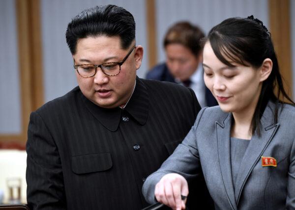 North Korean leader Kim Jong Un and his sister Kim Yo Jong attend a meeting