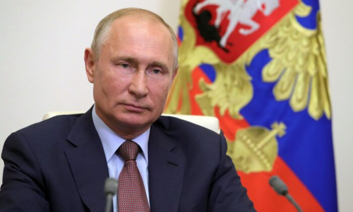 Russian State Exit Polls Show 76 Percent so Far Back Reforms That Could Extend Putin Rule