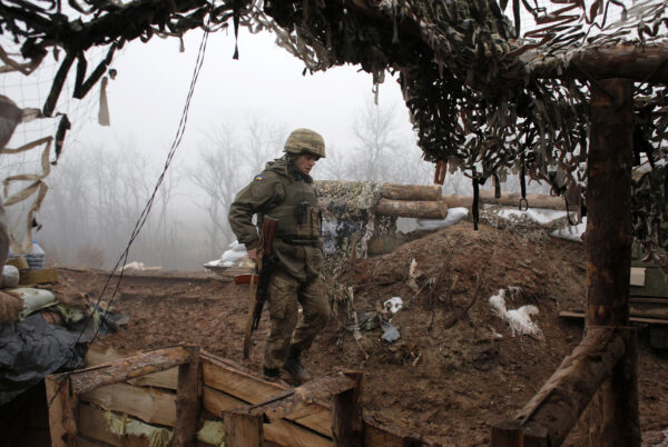 A Ukrainian soldier takes position