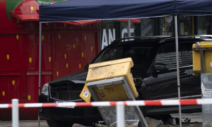 A car is parked after a collision with a group of people at Hardenbergplatz near a destroyed mailbox in Berlin Sunday, on July 26, 2020. The car drove off the road and into pedestrians. (Paul Zinken/dpa-Zentralbild/AP Photo)