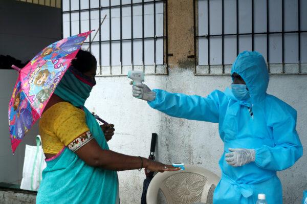 A nurse works inside a field hospital built on a soccer stadium in Kenya