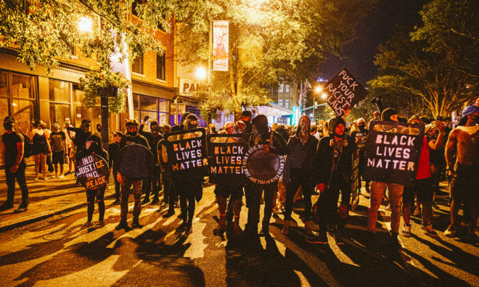 People carrying homemade Black Lives Matter shields march in front of protesters in Richmond, Va., on July 25, 2020. (Eze Amos/Getty Images)