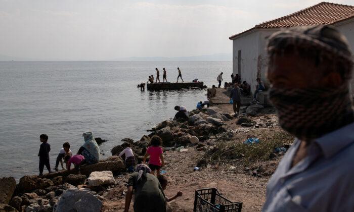 Greek Police Arrest Five Over Lesbos Fire, Migrants Resist New Camp