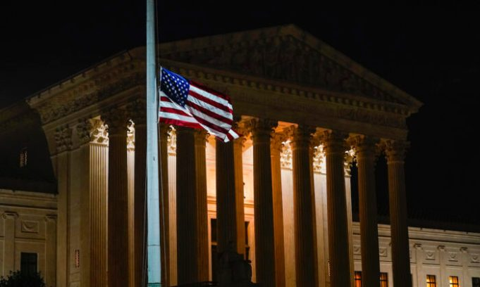 The American flag blows in the wind outside the Supreme Court on Sept. 18, 2020. (Alex Brandon/AP Photo)