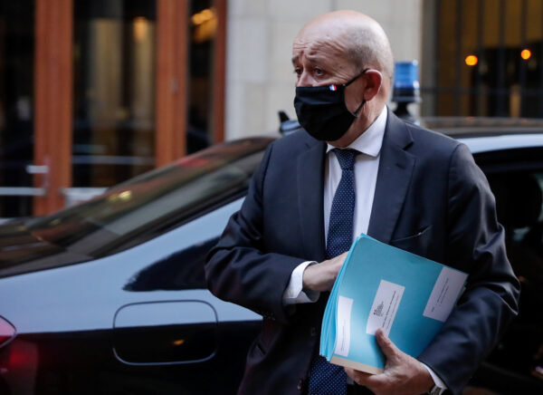 French Foreign Affairs Minister Jean-Yves Le Drian arrives at the Residence Palace