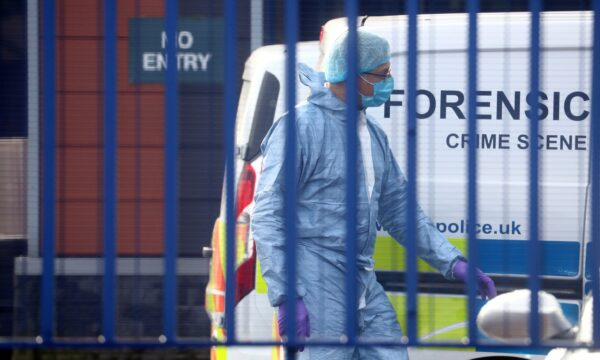 A forensic specialist is seen at the custody centre