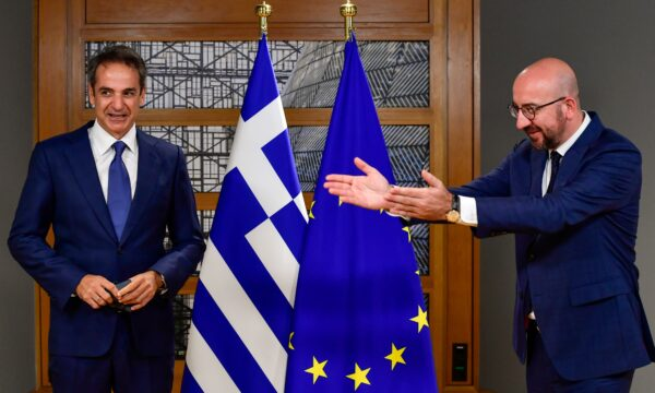 European Council President Charles Michel greets Greek Prime Minister Kyriakos Mitsotakis