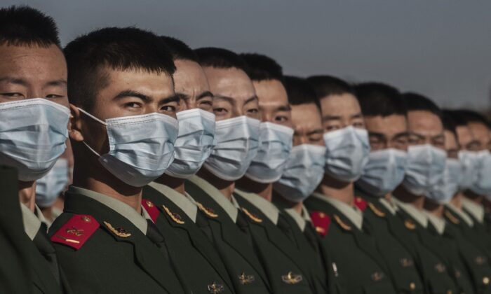 Chinese soldiers line-up after a ceremony marking the 70th anniversary of China's entry into the Korean War in Tiananmen Square in Beijing, China on October 23, 2020. (Kevin Frayer/Getty Images)