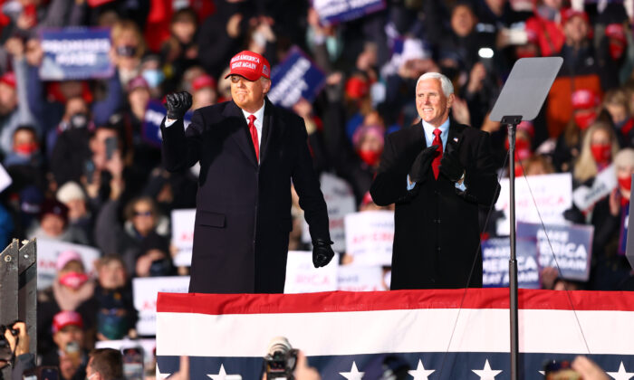 U.S. President Donald Trump (L) and U.S. Vice President Mike Pence (R) greet supporters at a rally in Traverse City, Michigan, on Nov. 2, 2020. (Rey Del Rio/Getty Images)