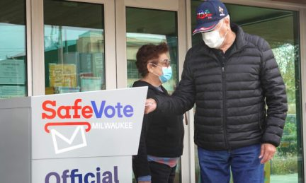 Residents drop mail-in ballots in a ballot box outside of the Tippecanoe branch library in Milwaukee, Wis., on Oct. 20, 2020. (Scott Olson/Getty Images)
