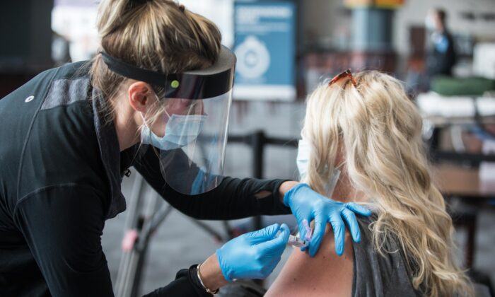A woman receives a COVID-19 vaccine at Gillette Stadium in Foxborough, Mass., on Jan. 15, 2021. (Scott Eisen/Getty Images)