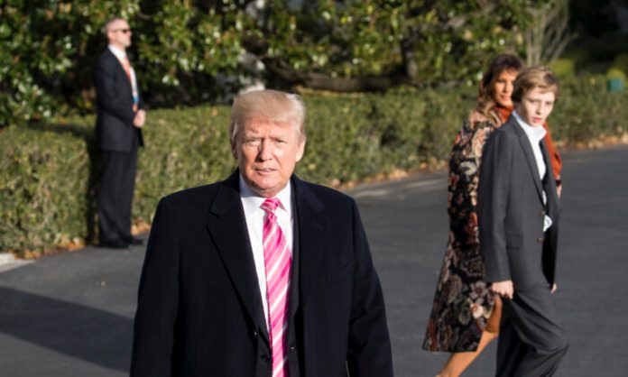 President Donald Trump talks to reporters before departing with his family from the White House to his Mar-a-Lago resort in Florida for the Thanksgiving holiday, in Washington on Nov. 21, 2017. (Samira Bouaou/The Epoch Times)
