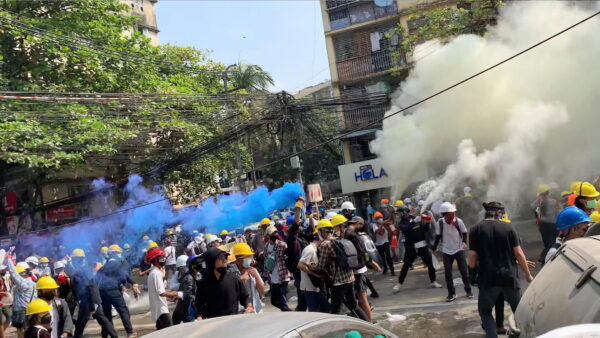 Protesters set off smoke grenades