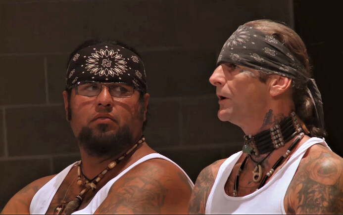 """Two men with bandanas and tank-tops in """"The Work"""""""
