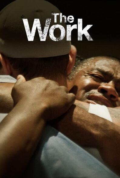 "two men hug in ""The Work"""