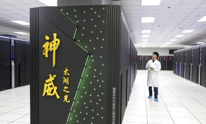 A worker monitors the Shenwei (Sunway) TaihuLight supercomputer at the National Supercomputer Center in Wuxi in eastern China's Jiangsu province on Aug. 29, 2020. (Chinatopix via AP)