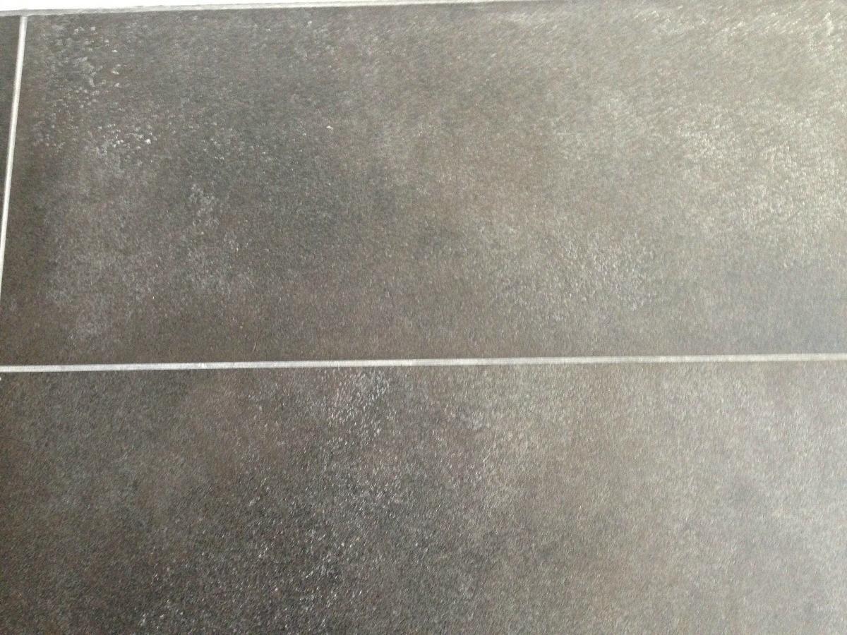 to clean talcum powder off tile floors