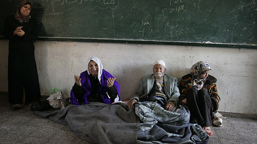 Palestinians at a school building in a refugee camp in Gaza