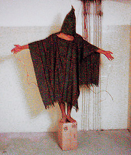 This Abu Ghraib detainee was reportedly threatened with electrocution if he fell.