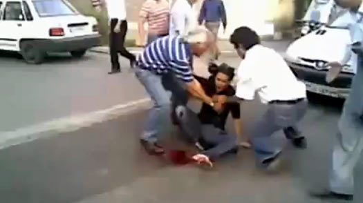 A screen grab taken on June 21, 2009 from a video posted on YouTube, allegedly shows Iranian men trying to help a wounded woman named