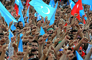 Protesters chant slogans and hold up flags in solidarity with Turkic-speaking Muslim Uighurs in Istanbul, on July 12, 2009.
