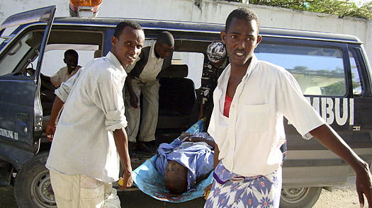 Civilians carry the body of a man killed in Mogadishu