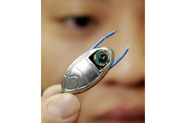 The surgical micro robot, only 2 cm. long, was built to work inside the human body. It can be attached to various kinds of medical devices like micro cameras,