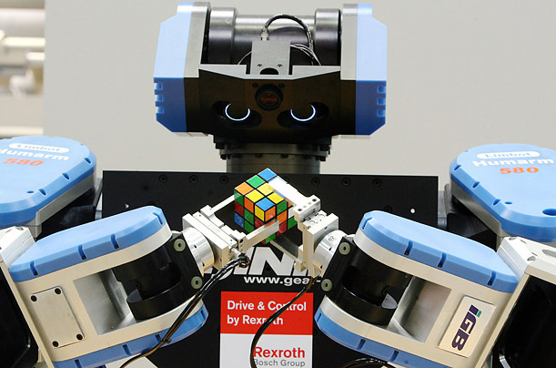 A robot solves a Rubik's Cube at the trade fair grounds in Hanover, Germany. Though still not as fast as humans, Rubik's cube-solving automatons have been