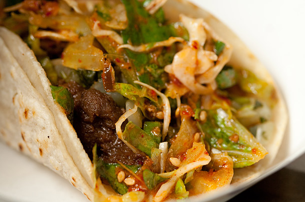 Kogi's menu is a mashup of Korean and Mexican food, like short-rib tacos, above, which are stuffed with beef prepared in a soy-based marinade. Kogi se