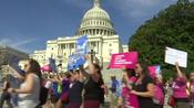 Demonstrators encircle U.S. Capitol in protest of healthcare bill