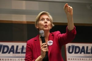 U.S. Sen. Elizabeth Warren (D-Mass.) speaks to a crowd during a rally to urge the reelection of Sen. Mark Udall (D-Colo.) on the campus of the University of Colorado, in Boulder. (Brennan Linsley/AP)