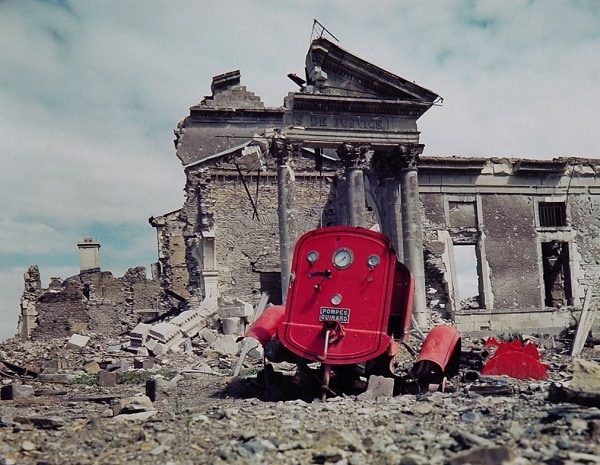 View of the ruins of the Palais de Justice in the town of St. Lo, France, summer 1944. The red metal frame in the foreground is what's left of an obliterated fire engine. (Frank Scherschel—Time & Life Pictures/Getty Images)