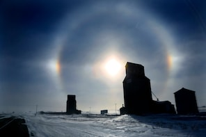 CORRECTS MEMBER NAME  and ADDS RESTRICTIONS- With temperatures at about 22 below zero with a -50 windchill, it was hard to find the beauty in the brutal weather in Bismarck, N.D., Sunday, Jan. 5, 2014. Sundogs, a ring of light visible around the sun or moon when light is refracted through ice crystals in the atmosphere, are quite beautiful along Highway 83 north of Bismark ND. (AP Photo/The Star Tribune, Brian Peterson)  MANDATORY CREDIT; ST. PAUL PIONEER PRESS OUT; MAGS OUT; TWIN CITIES TV OUT  MBO