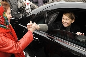 Ukrainian opposition leader Yulia Tymoshenko shakes hands with a woman as she arrives to visit the tent camp of her supporters in the center of Kiev on February 28, 2014. Judicial authorities in Geneva said Friday they have launched a criminal investigation into alleged money laundering by ousted Ukrainian leader Viktor Yanukovych and his son. The Swiss government also announced it was freezing the assets of 20 Ukranian officials, including Yanukovych and his son and a number of former ministers. AFP PHOTO/ YURIY DYACHYSHYNYURIY DYACHYSHYN/AFP/Getty Images