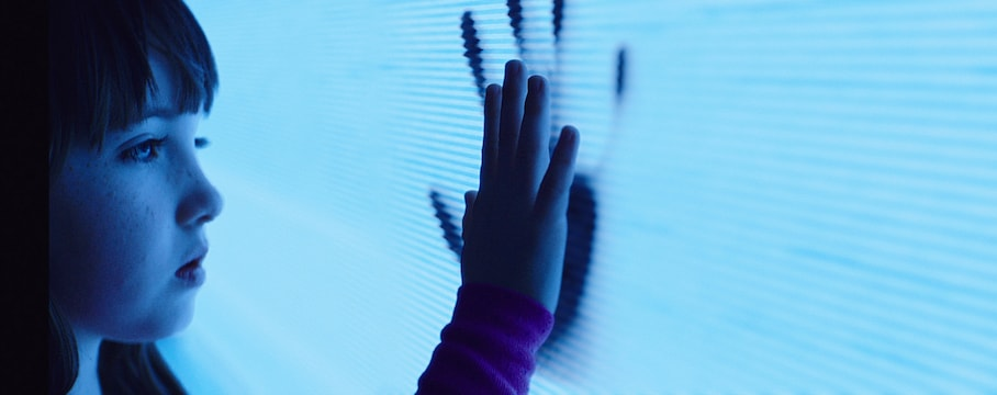 "This photo provided by Twentieth Century Fox shows, Kennedi Clements as Madison Bowen, reaching out to apparitions that have invaded her family's home in a scene from the film, ""Poltergeist."" (Twentieth Century Fox via AP)"
