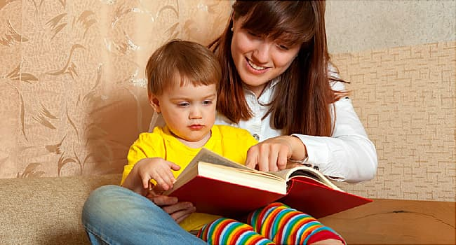Mother showing book to her baby