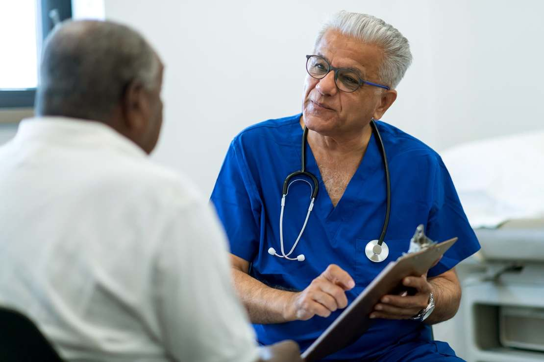 photo of doctor and mature patient