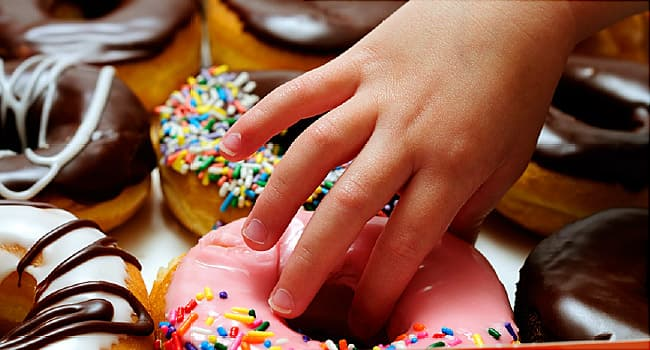 hand reaching for doughnut