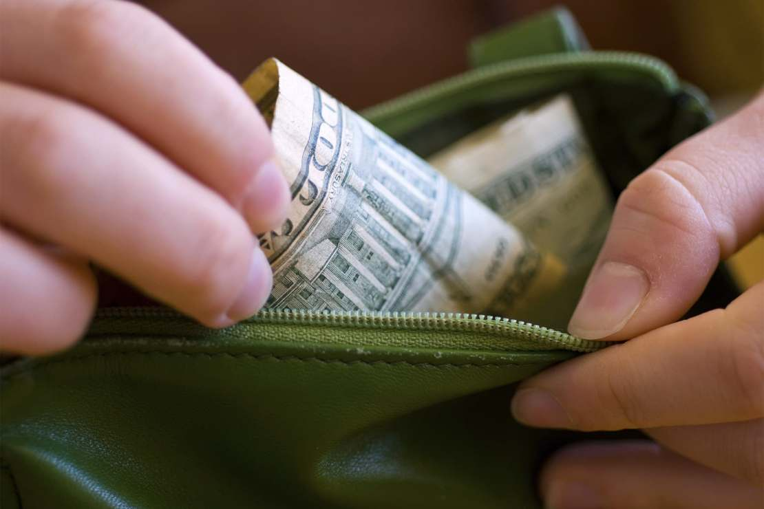 pulling money out wallet