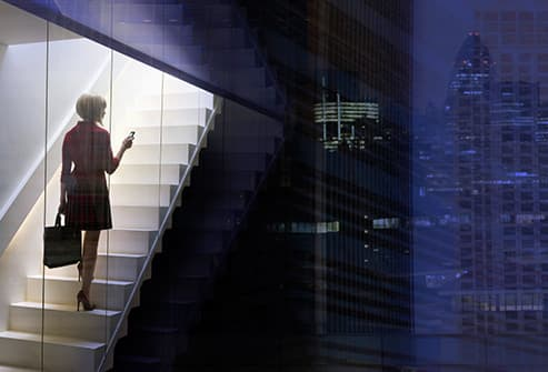 woman on stairs in office