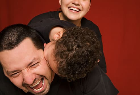 Father laughing with son